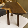 Dave Grieve made a very unusual small table from walnut. The top has an irregular shape including its thickness.  This made it difficult to position and cut the legs to produce a level top.