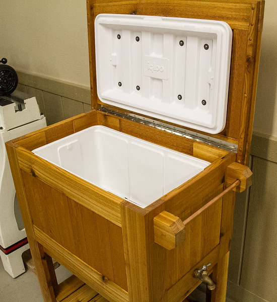 John McKee showed his cooler stand made with Cedar wood. This is a Woodsmith plan but be sure to reinforce the top with end rails or it may crack just above the hinges.