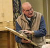 Rich Voss demonstrated his jig for holding a hand-held belt sander that makes it easy to smooth the edges of a board while keeping them square. Jan 2014