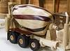 Francis Youngblut had his latest vehicle creation… a mobile cement-mixer truck. It has a drop down 3rd axle and was made from maple and paduk. Jan 2014