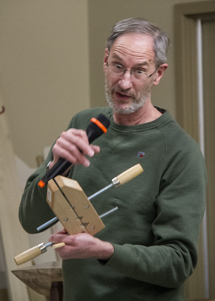 Butch McClintic showed a wood clamp he modified to hold dowels while he drills holes in their ends on his drill press.
