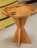 "Bill Hopkins showed his small round side table made with a tree stump and inlayed with ""butterflies"" across the splits in the log. The legs duplicated the ""butterflie"" shape."