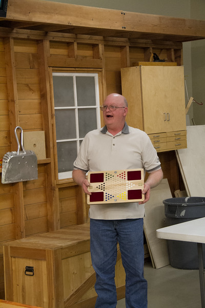 Club Librarian Rex Bloem tried out the Club's Chinese Checker Plan. He modified by adding a hinged middle, closure magnets and cloth pockets to hold the games 60 marbles.  Mar 2015