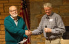 "LeRoy Monson (left) received the  People's Choice 3rd Place Turners award from John Twedt for his Artistry in Wood entry ""Multi Axis<br /> Goblet"". Dec 2013"