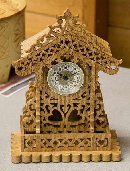Richard Hawbaker showed his clock that he scroll-sawed for a friend. A lot of detail and time at the saw. Mar 2013