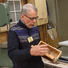 "Tom Whalley demonstrated his jig for making a straight edge on a rough-edged board. The jig can also be used to cut equal length boards. He also had a very unique box made from box elder with a top made with a ""turkey tails"" design. Jan 2014"