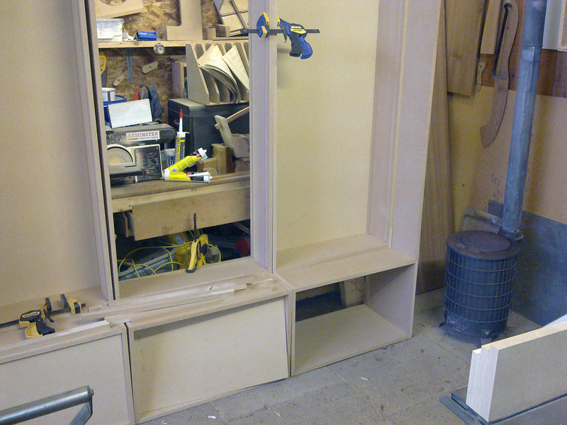 "Custom made moving bookcase system by  <a href=""http://www.harrisonwoodwork.com"">http://www.harrisonwoodwork.com</a>"
