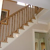 "The new Hanrail and spindles are completed. The ends of the Stair treads have also been covered with oak to blend in with the handrail. installed by  <a href=""http://www.harrisonwoodwork.com"">http://www.harrisonwoodwork.com</a>"
