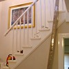 "The old spindles and handrail before removal. The Lower newel post has already been removed. installed by  <a href=""http://www.harrisonwoodwork.com"">http://www.harrisonwoodwork.com</a>"