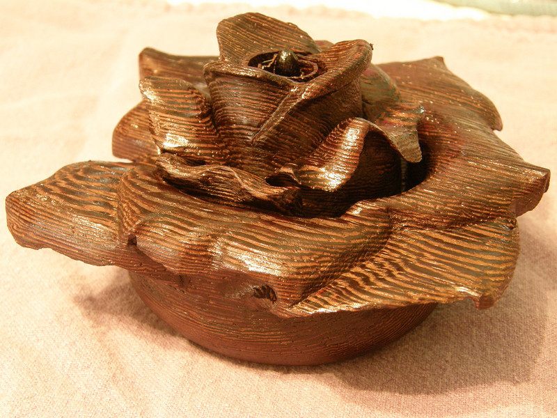 """Wenge Wood Rose made in three concentric pieces so as to get the undercuts. Roughly 5"""" in diameter, this takes about 2 to 3 days using a hobby drill with multiple burr bits."""