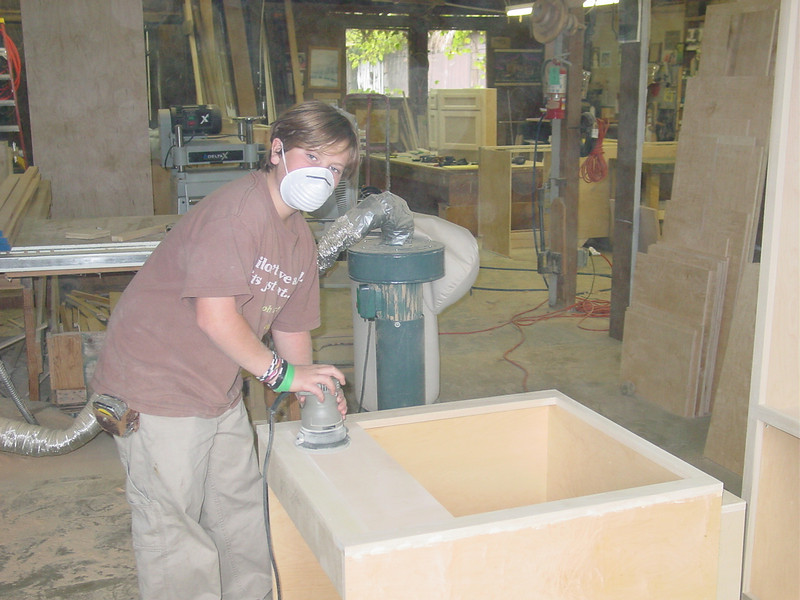 Thor, sanding his first cabinet