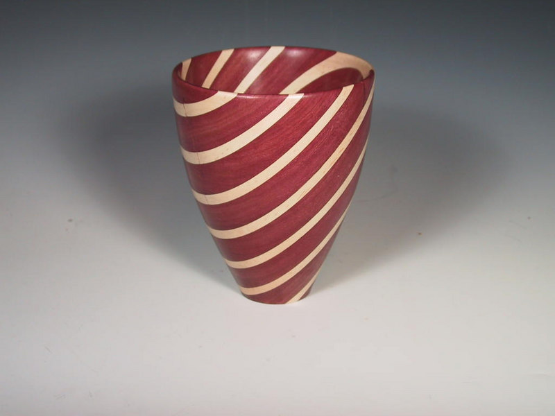 "Ben Swartz turned this segmented vase which is about 10"" tall and represents a new technique that Ben is beginning to explore."