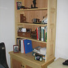 Ash bookshelf on cabinet base.  Bookshelf back and door panels are red oak plywood.  I built two as a matching set.
