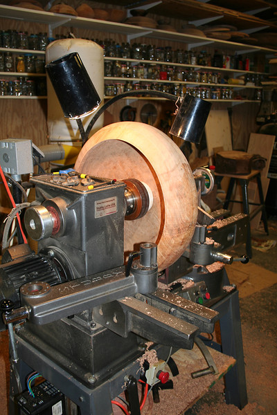 """A view of the inside of the bowl showing the """"jamchuck"""" that allows<br /> Patty to work on the bottom of the bowl.  The only thing keeping the<br /> bowl centered and secure are this jamchuck and the tailstock of the lathe."""
