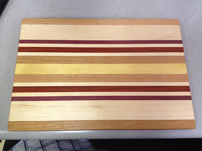 """Finished SSI Door Prize.  Finished with 2 coats of GF Salad bowl finish (food safe) and a coat of Rennaisance Wax for a bit of a shine.    About 13"""" x 9"""" and 5/8"""" thick."""