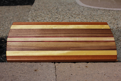 This one has Cherry, Purpleheart, Walnut, Yellowheart, and Jatoba.  It was made for Dr Ripepi, to thank him for taking out my splinter :-)