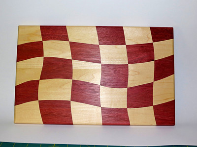 Drunken Cutting Board.  Purpleheart and Maple.  2 coasts of General Finishes Salad Bowl finish