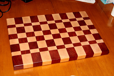Fran's board from Paduuk and Hard Maple.  This is an endgrain board.  Rediculously hard and heavy.