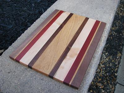 Stacy's Board from Brazilian Oak, Rosewood, Birdseye Maple, Bloodwood, Brazilian Oak again, and Black Walnut