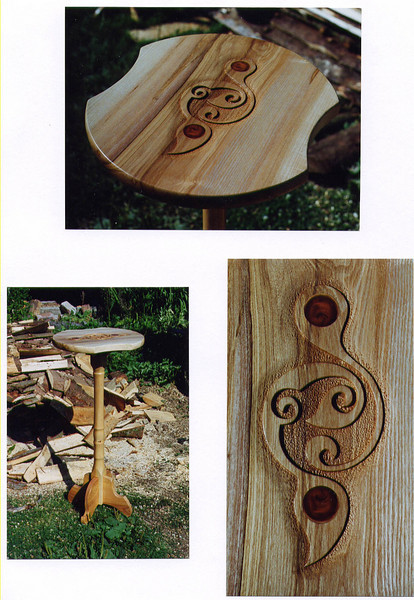 Carved side table.<br /> <br /> Ash top and feet with a sycamore leg and yew inserts in the carving.