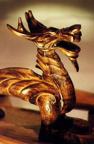 Dragon.<br /> <br /> Hand carved and standing about 6 inch tall this was a piece carved in 1998 as one of my first sculptures. Carved from local Lime, burnished and oiled for effect.