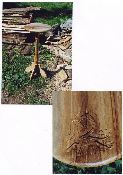 Carved side table with dog design.<br /> <br /> Completely made from local ash with a dog motif hand carved in the top.