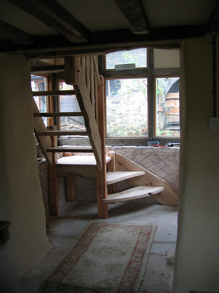 Handbuilt stair in Wales.<br /> <br /> I was asked to build this stair for a friend in north Wales, I have no photos of the room finished but these show the design well enough. Built from yew and ash with a mixture of modern construction and traditional methods.