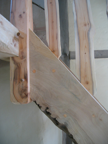 Satir detail.<br /> <br /> Showing natural edged timber and branch cut handrail spindles.