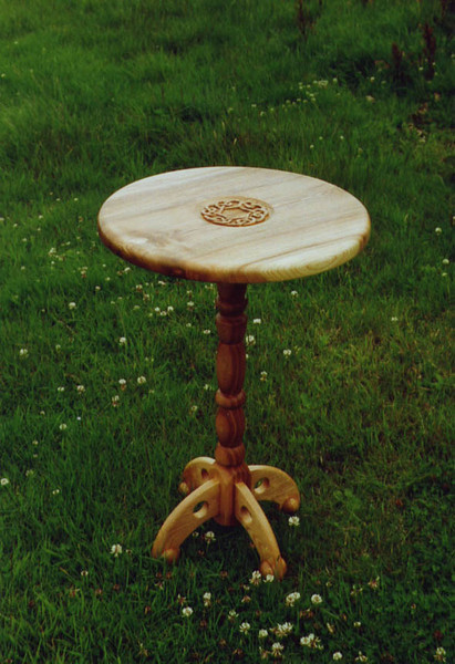 Ash side table.<br /> <br /> Carved ash top with a celtic moiif and a turned leg, designed as a side table.