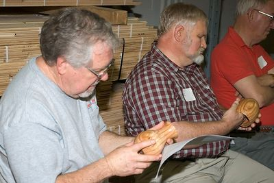 Members examine a couple of hollow vessel turned by Leroy.Return to Woodworkers Guild
