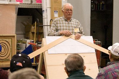 Alfred also demonstrated a method for laying out an eliptical arch.  Nails are partially driven into the template at the peak and both ends of the arch.  The nails define the angle of the layout boards. Return to Woodworkers Guild