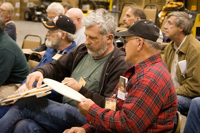 A couple of members examine the results. Return to Woodworkers Guild
