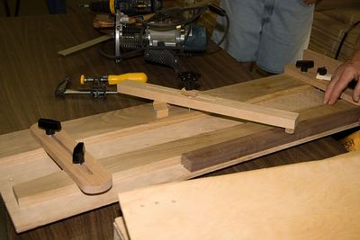A better view of the hold-downs on the tapering jig.Return to Woodworkers Guild