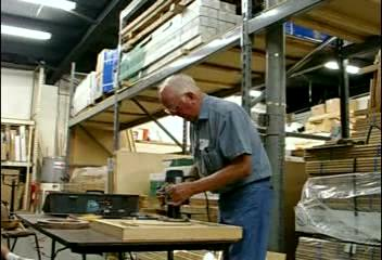 (Video) Alfred carefully lowers the bit as he moves the router around the oval.  The process actually took a bit over two minutes.  It's shortened here to keep the length of the video managable.(click on the image to start the video)  Return to Woodworkers Guild