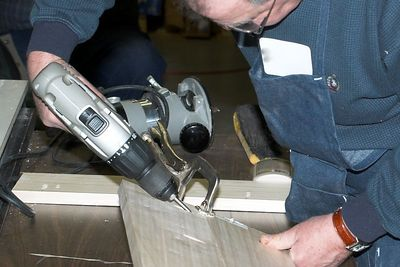 Driving a screw in to a pocket hole.Return to Woodworkers Guild