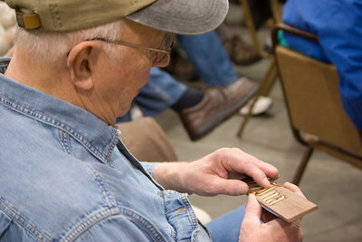 Show and Tell - Alfred checks a sample engraving.