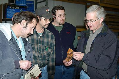 Members view sample carvings.