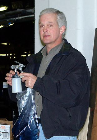 Member demonstrates a small spray gun.