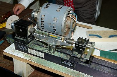 The miniature lathe is powered by an old washing machine motor.Return to Woodworkers Guild