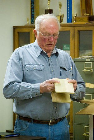 His sample was joined with dovetails.  He also presented a mitred alternative.