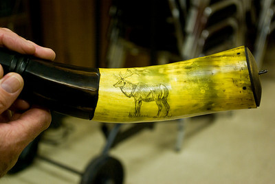 He decorated the horns with scrimshaw.
