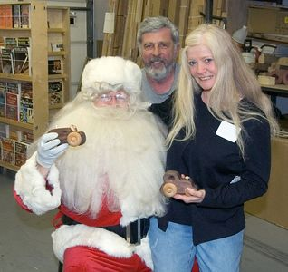 One of our members and his wife with Santa.Return to Woodworkers Guild