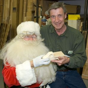 Santa and a member.Return to Woodworkers Guild