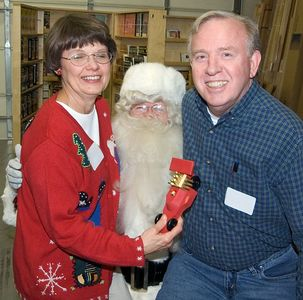 One of our members, his wife and Santa.Return to Woodworkers Guild