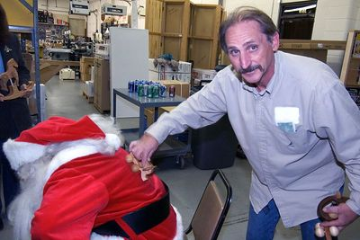 After hauling all those toys, one of our members helps Santa work the kinks out of his back.Return to Woodworkers Guild