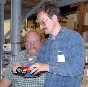 Doug demonstrates his rocket powered racer.Return to Woodworkers Guild