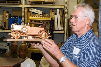 One of the members shows off his model of a favorite automobile.Return to Woodworkers Guild