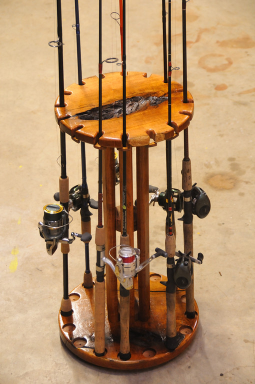 """Solid Mesquite rod and reel holder. This Rod holder holds 16 rods and has a individual lock for each rod.  Mounted on a """"Lazy Susan"""" so the entire unit spins to get the equipment in front of you."""