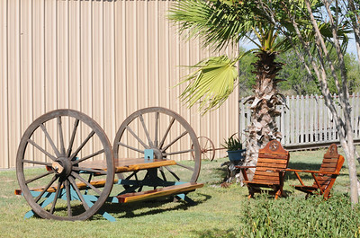 """Wagon Wheel Picnic Table.  Large wagon wheels on axles to allow table to be rolled where needed. Table top and seats are Red Cedar cut to 3 inch thickness.  Table top 36"""" X 96"""", seats 14"""" X 96"""". Legs lock in up and down position."""