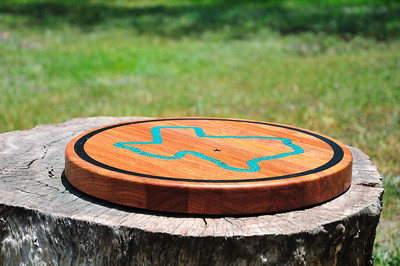 """Lazy Susan Mesquite Cutting Board, 1 1/2"""" X 15"""" with ebony wood ring inlay.  Texas shaped turquoise inlay placed inside the ebony inlayed ring.  The star is placed in the Ingram Texas area.  This is going to a home in Ingram Texas."""